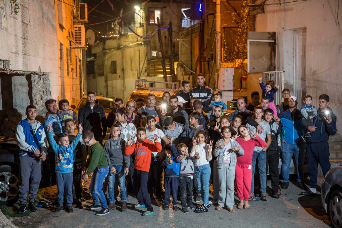 Palestinian residents of Batan Al-Hawa, Silwan, 2018. All of them are under threat of eviction. Photo: Emil Salman, Haaretz.